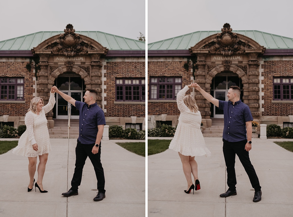 Couple dancing in front of Belle Isle Aquarium for engagement photos. Photography by Nicole Leanne Photography