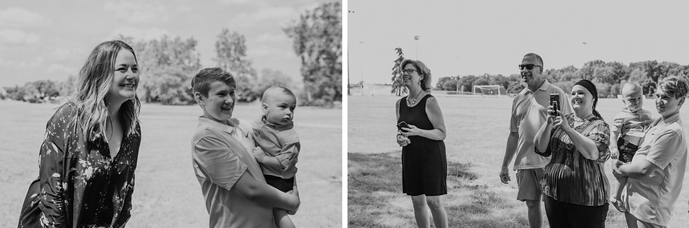 Wedding guests watching wedding ceremony at park in Metro Detroit. Photographed by Nicole Leanne Photography.