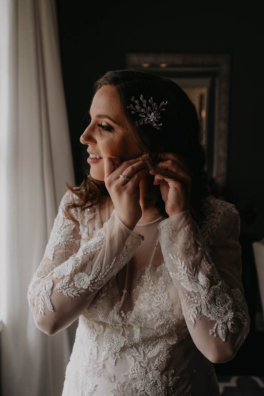 Bride getting ready for wedding day. Photographed by Nicole Leanne Photography.