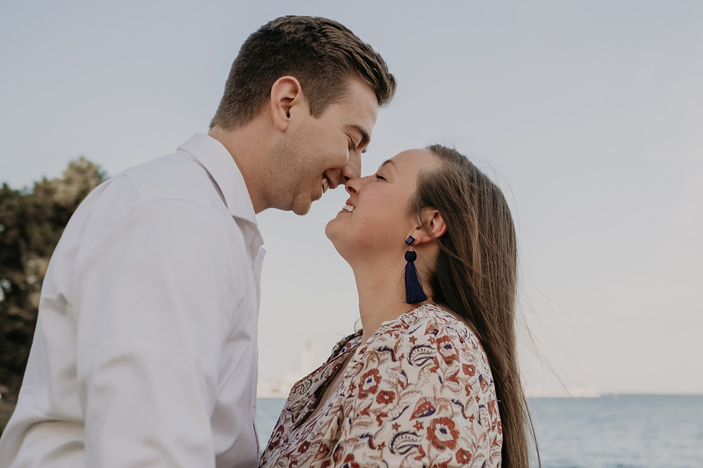 Couple kissing during engagement photos in Metro Detroit. Photographed by Nicole Leanne Photography.