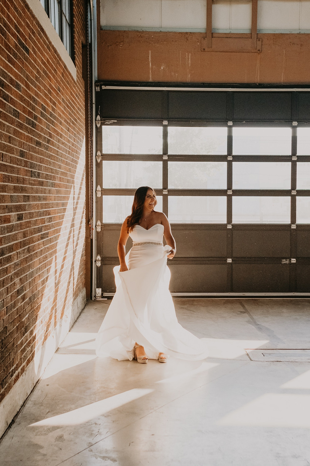 Bride in Eastern Market wearing wedding dress. Photographed by Nicole Leanne Photography.