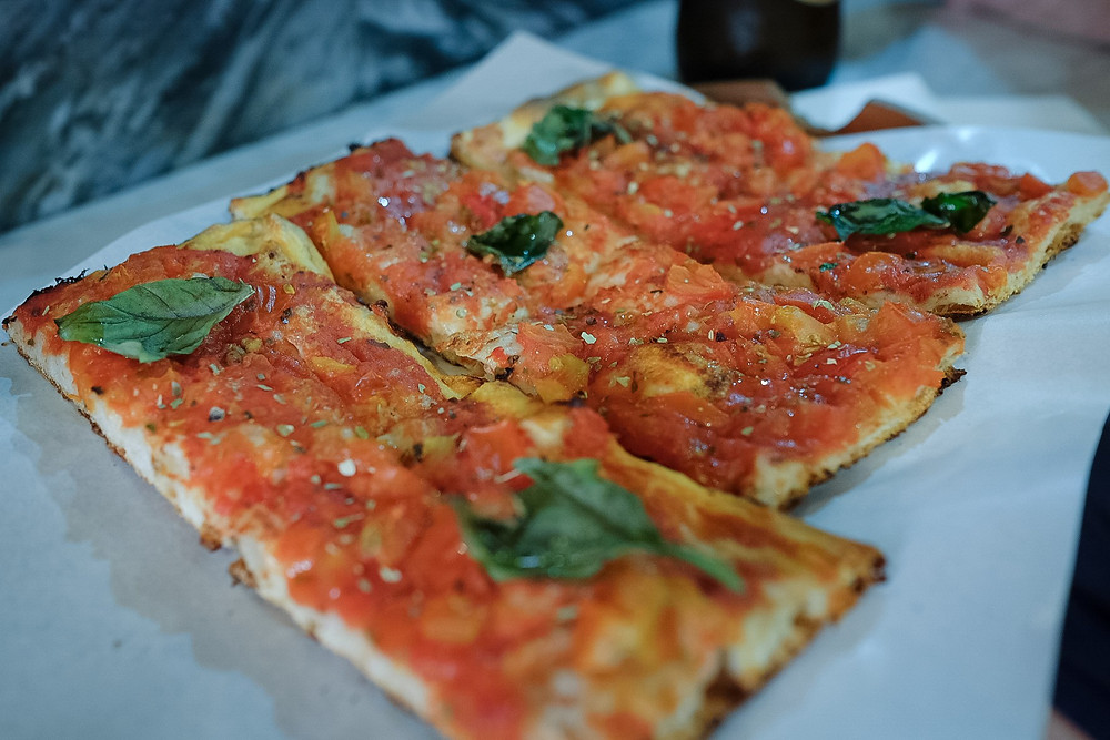 Pizza in Rome. Photographed by Nicole Leanne Photography.