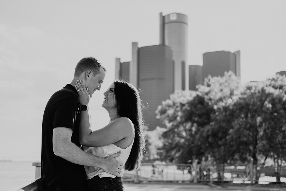 Downtown Detroit proposal at Detroit RIverwalk with GM Renaissance Center in background. Photographed by Nicole Leanne Photography