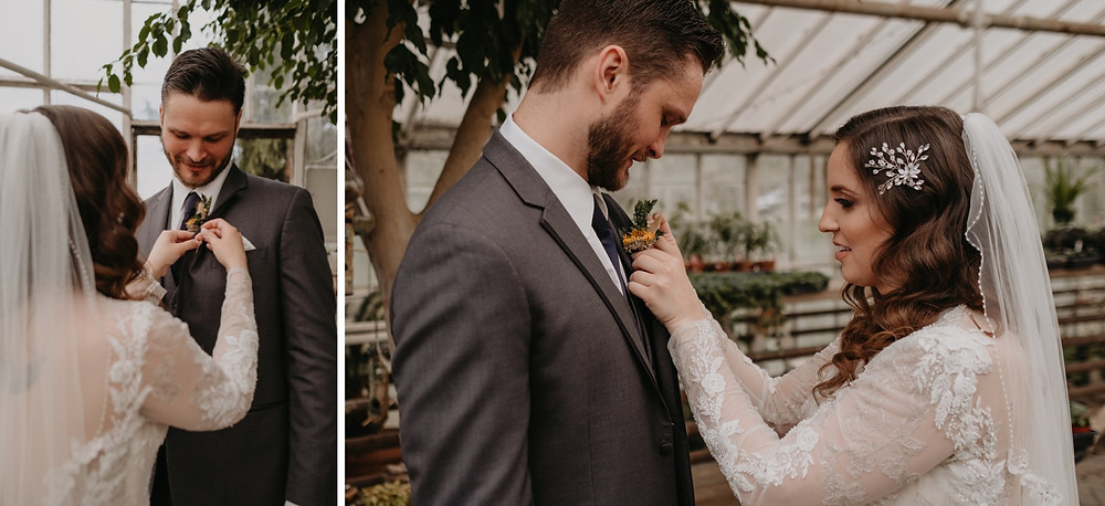 Bride pinning boutonniere on Groom. Photographed by Nicole Leanne Photography.