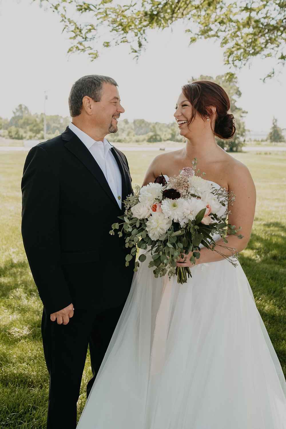 Bride and her father on wedding day. Photographed by Nicole Leanne Photography.