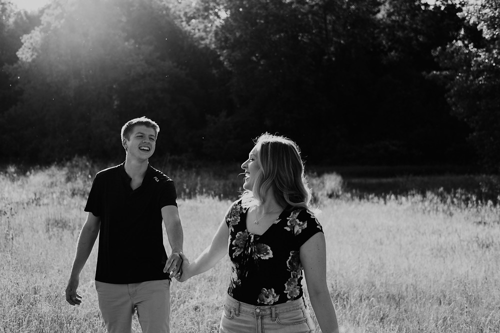 Couple holding hands at Stony Creek Metro park. Photographed by Nicole Leanne Photography