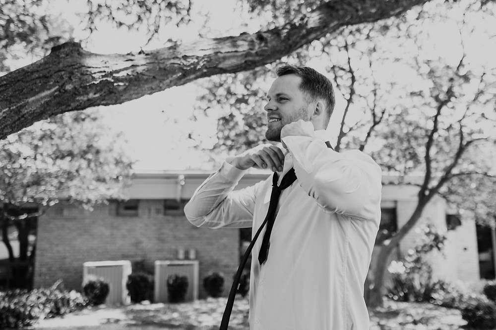 Groom getting ready on wedding day. Photographed by Nicole Leanne Photography.