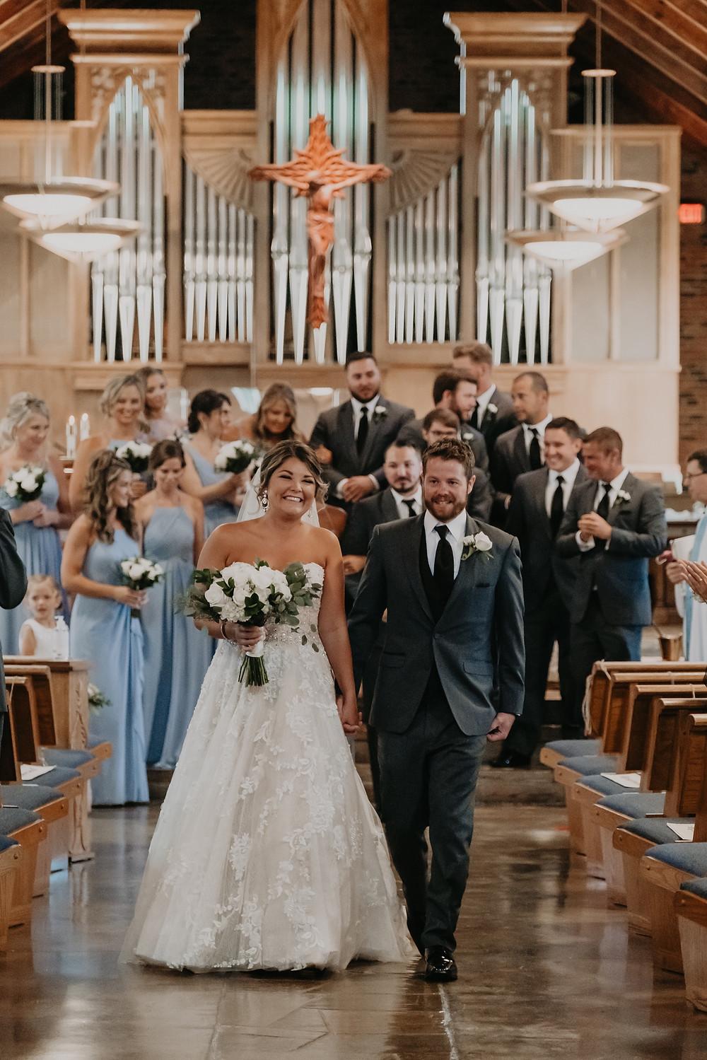 St. Josephs Catholic Church Metro Detroit wedding ceremony. Photographed by Nicole Leanne Photography.