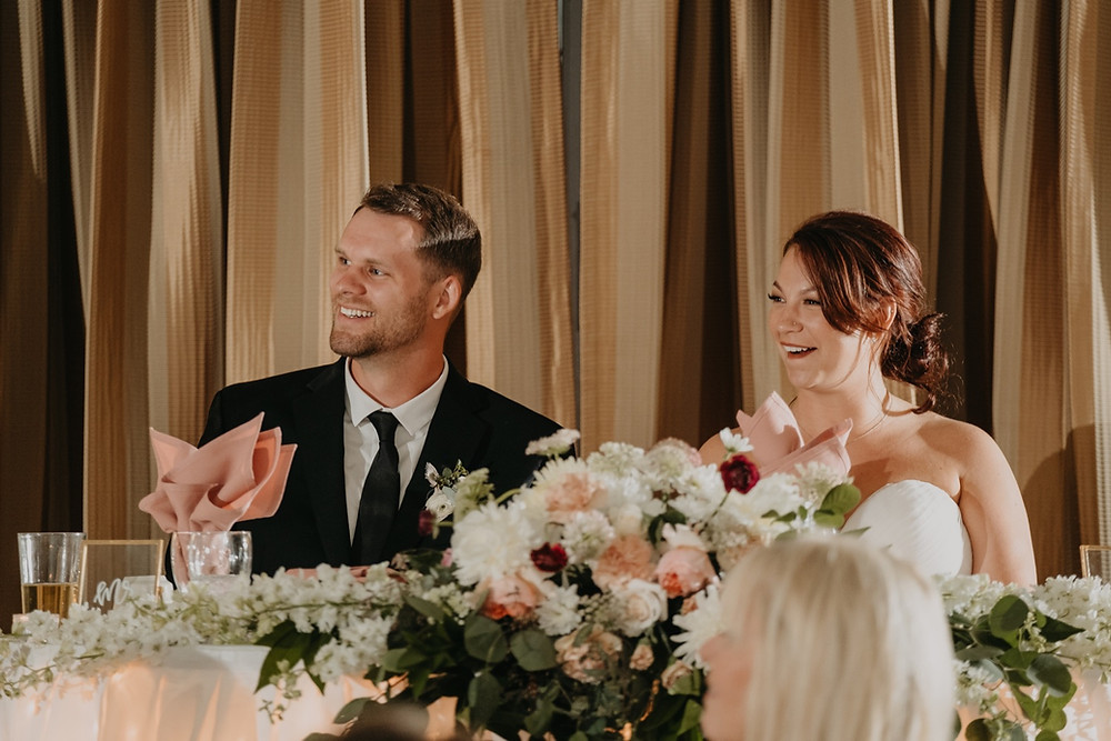 Bride and groom candids at wedding reception. Photographed by Nicole Leanne Photography.