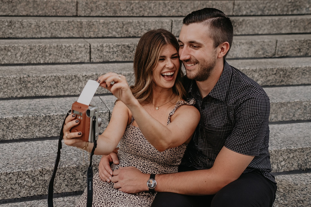 Couple using instant film camera. Photographed by Nicole Leanne Photography.
