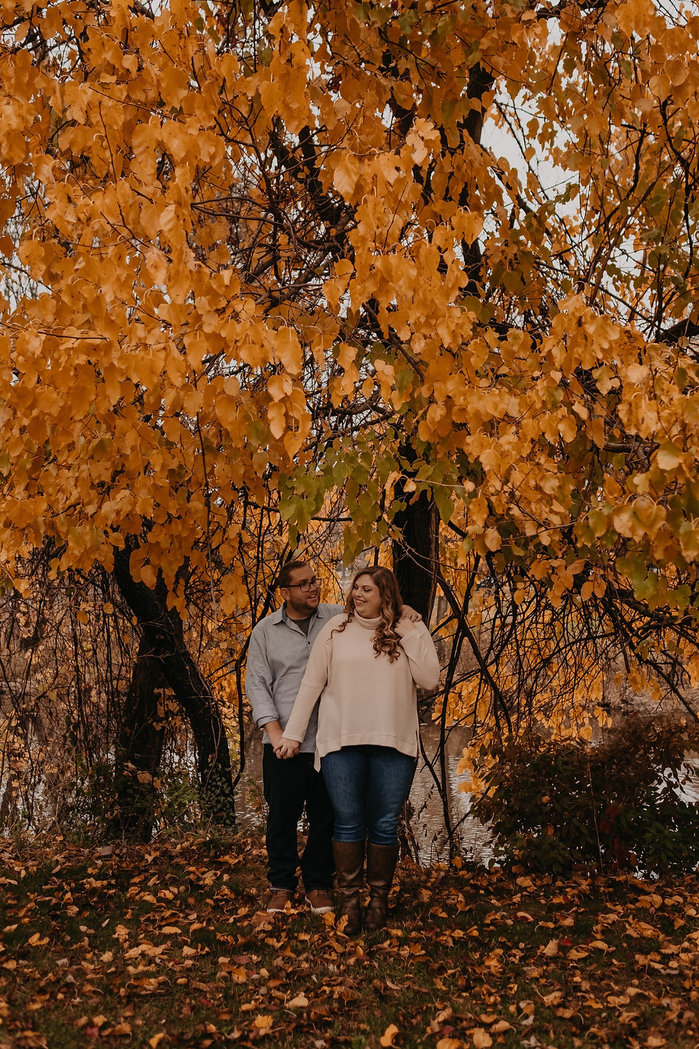 Engaged couple in fall colors in Michigan. Photographed by Nicole Leanne Photography.