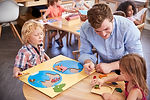 Teacher And Pupils Using Wooden Shapes I