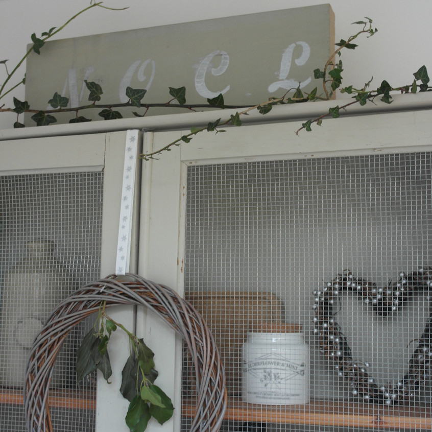 Ivy and wooden noel sign