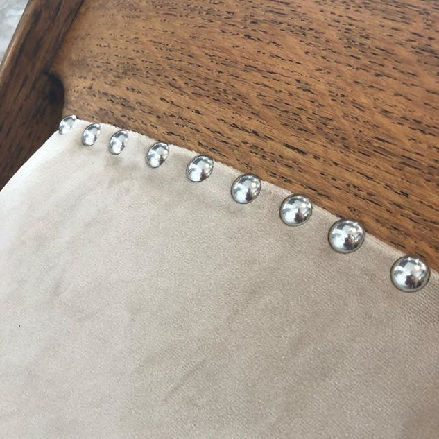 Details...upholstering a chair with stud
