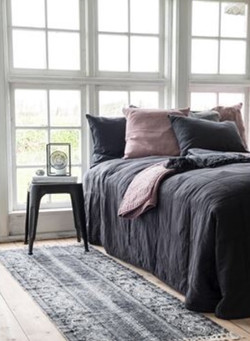 bedroom with grey and white rug and grey