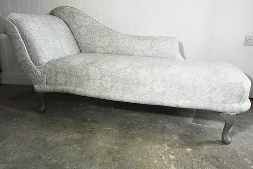Grey upholstered floral chaise