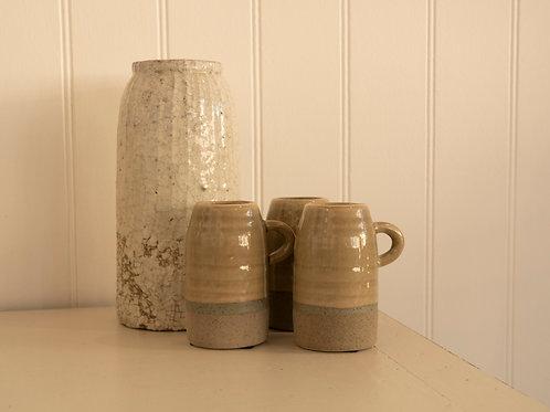 Small rustic moss green glazed jug