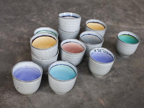 Colourful glazed ceramic mugs