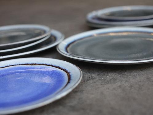 Colourful glazed ceramic dinner plate