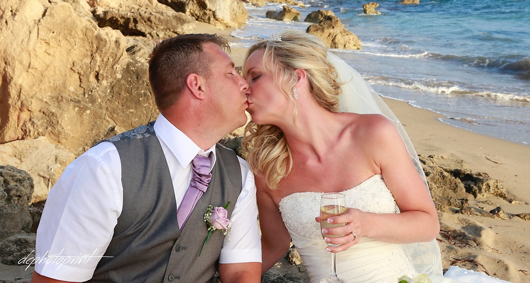 Bride and Groom, Kissing at Sunset on a Beautiful Paphos Beach | cyprus wedding photographers prices Paphos beach hotels, cyprus wedding photographers prices Paphos beach cyprus