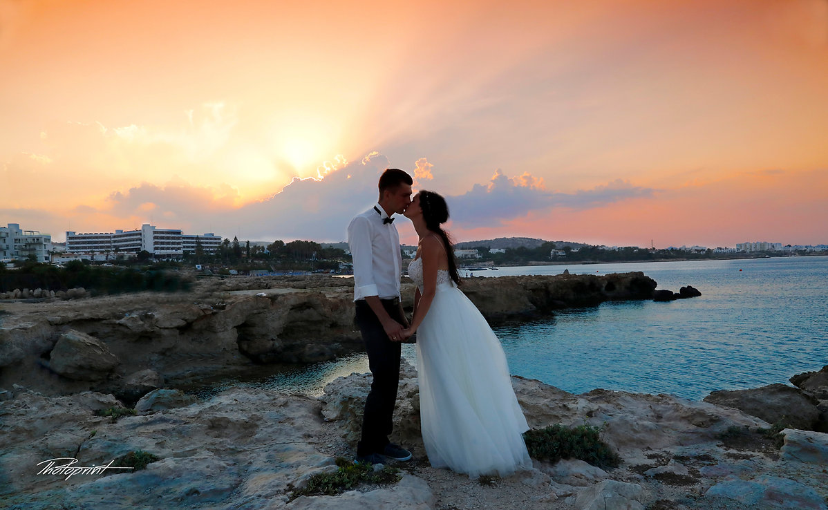 The beautiful bride with the most striking blue eyes at Sunset in a Beautiful Mediterranean, ayia napa Beach | Bespoke wedding pictures ideas of bride and groom in cyprus