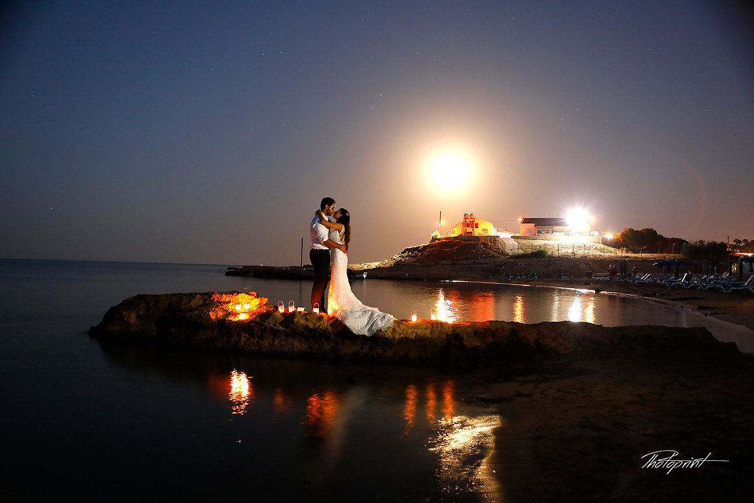 Midnight Blue Coastal Moon rise With starry sky, Bride and Groom on Protaras sea beach without Waves  |  wedding venues in protaras cyprus, cyprus weddings in protaras, protaras wedding photography
