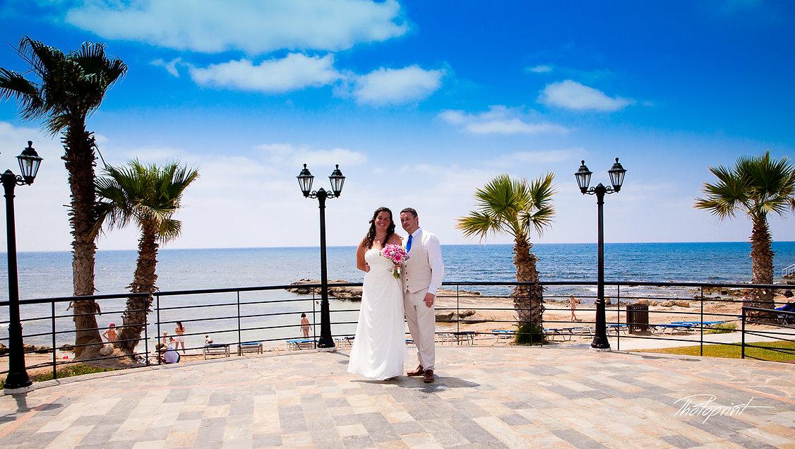 Gorgeous blonde bride and stylish groom, mediterranean blue Sea on background | cyprus wedding photographer cheap paphos, cyprus cheap wedding photographer paphos, city hall paphos wedding photography