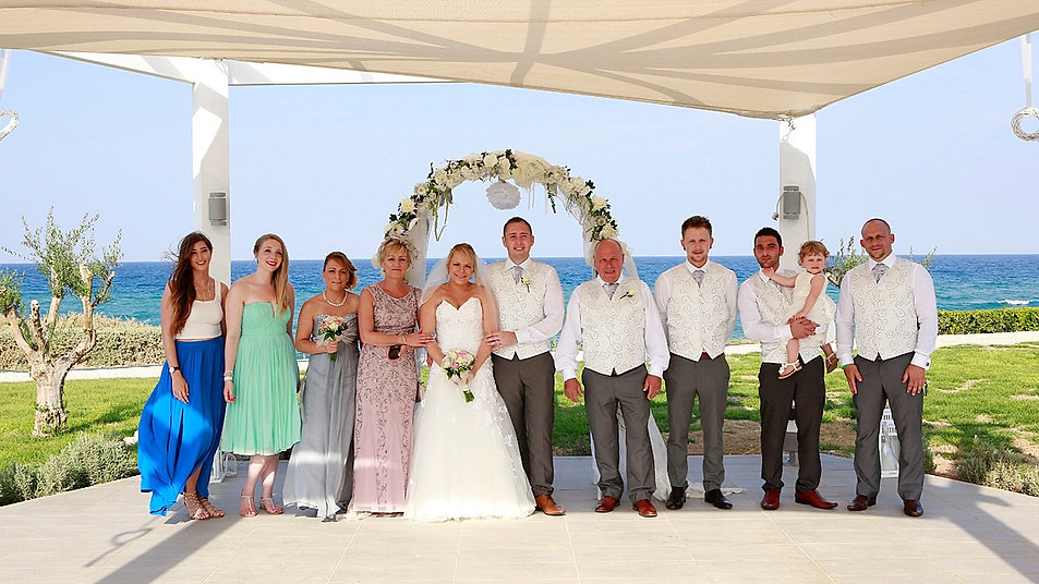 family, guests, bride and groom wedding photo after the wedding ceremony at Pernera Beach Hotel, in  Protaras, cyprus | wedding in protaras photography, civil weddings in protaras  photography