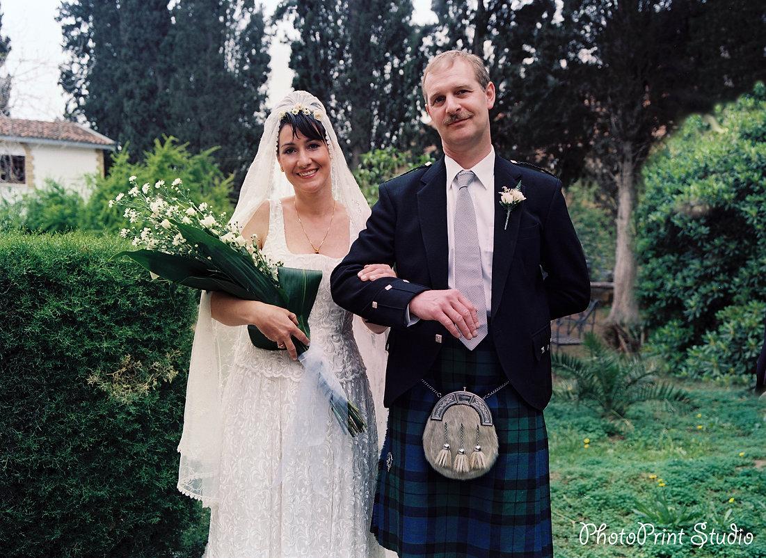 Elegant smiling bride walking on the garden