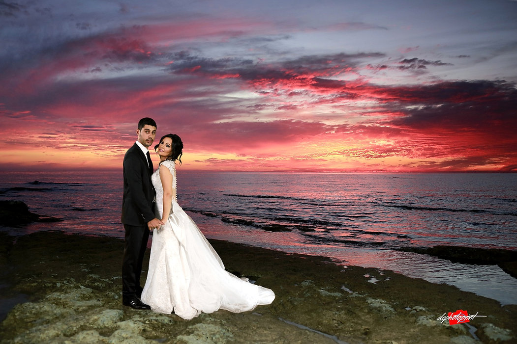 Bride and Groom, Kissing at Sunset on a Beautiful Mediterranean Paphos Beach | wedding paphos photographers photography, wedding venues paphos cyprus