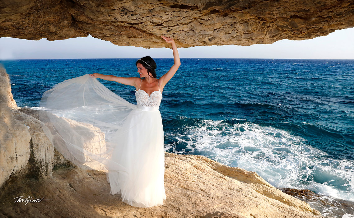 Gorgeous young bride with dark hair in elegant wedding dress at Gavo Greco, cyprus | ayia napa municipality best wedding photography, ayia napa town hall ceremonies
