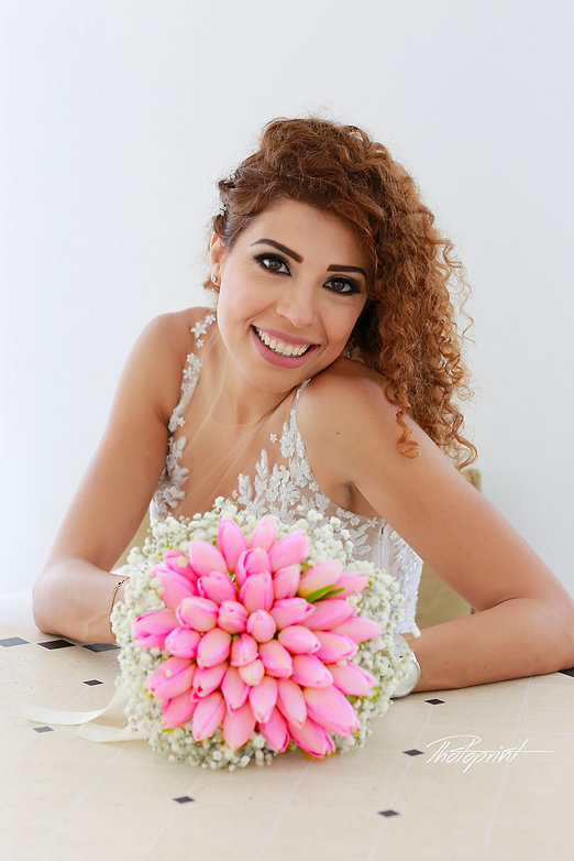 Gorgeous bride in wedding dress with bouquet of flowers posing | budget wedding photographer protaras, Protaras cheap but good wedding photographers, Protaras cheap wedding photographer, protaras cheap wedding photographers