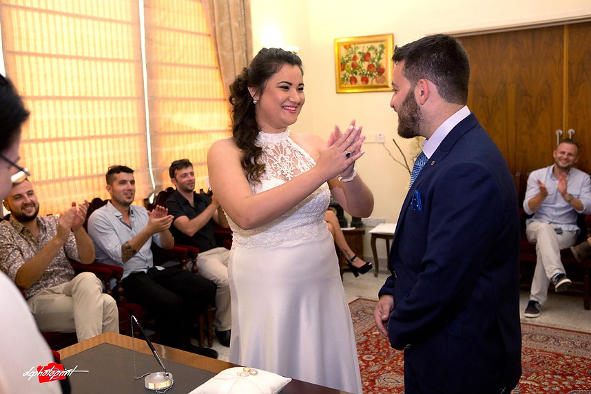 Happy couple swearing love to each other during wedding ceremony in town hall Paphos | cyprus weddding photographer photography paphos, cyprus weddding photographer paphos