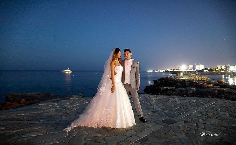 Midnight Blue Coastal Moon rise With starry sky, Bride and Groom on Protaras sea beach without Waves | wedding portfolio