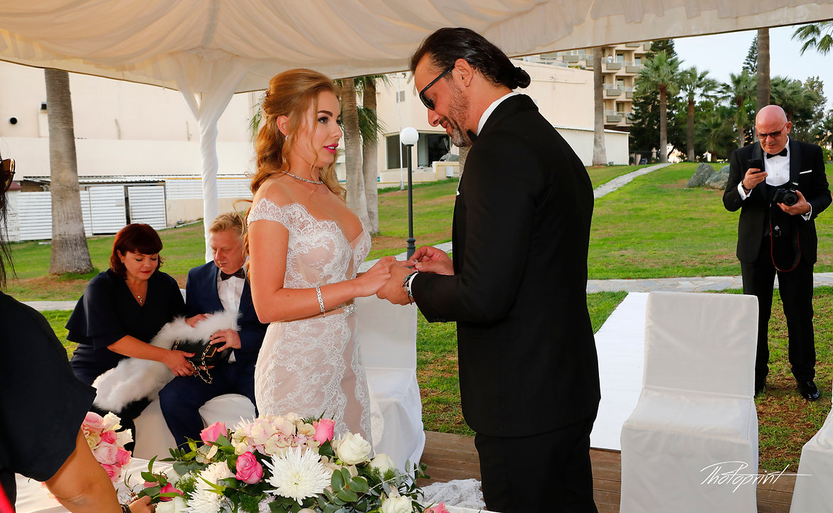 Salah Put the Wedding Ring on Yuliia's finger in the wedding ceremony  |  weddings in larnaca, larnaca wedding phographers,larnaca wedding abroad