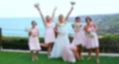Bride with bridesmaids holding bouquets outdoors on the wedding day celebrate |  wedding photographers for wedding in protaras, best photography protaras wedding venues