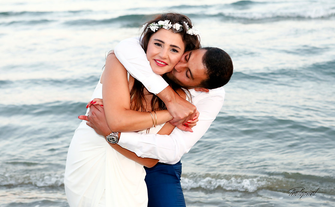 Picture of Elegant beautiful Just married couple romantic on the sea, kissing | wedding venues  Larnaca cyprus, wedding packages in Larnaca