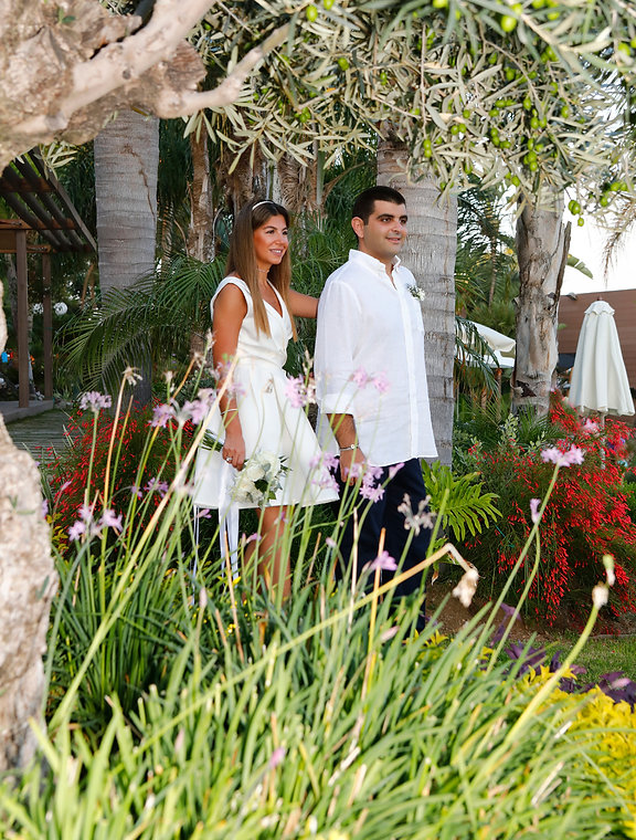 Elegant smiling bride and groom walking on the garden before the wedding at Amathus Beach Hotel in Limassol | cyprus wedding venues photographers limassol, wedding limassol photographers