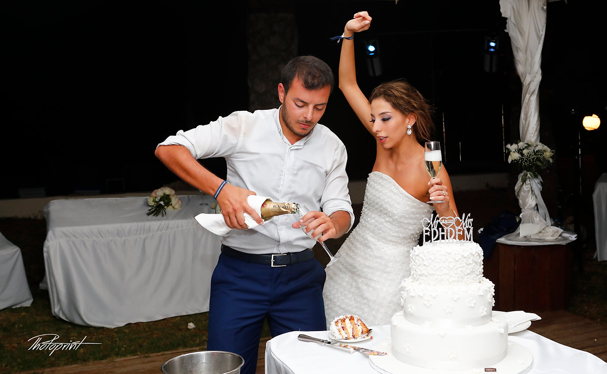 Bride and groom holding champagne glasses celebrating and have fun | cheap wedding photography cyprus, photography websites cyprus, wedding photographers cyprus, wedding photo cyprus