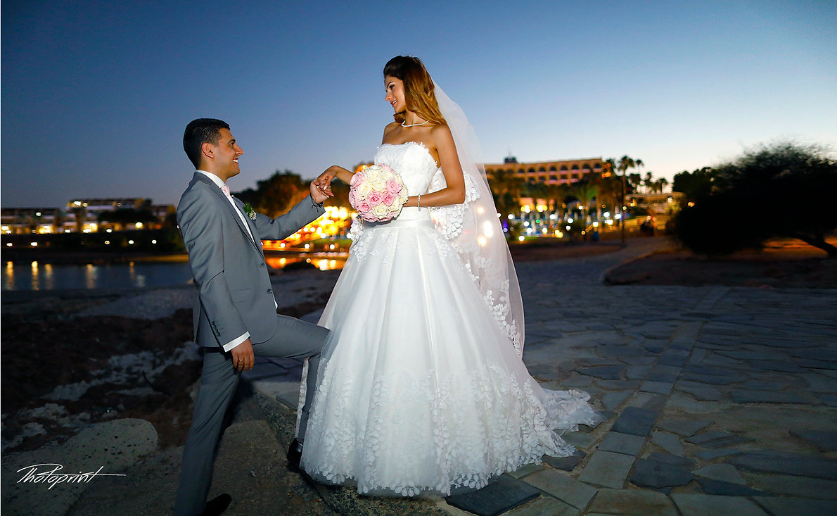 Wedding couple enjoying romantic moments outdoors at night  |  cheap wedding photography cyprus,cyprus wedding photos, cyprus wedding photographers