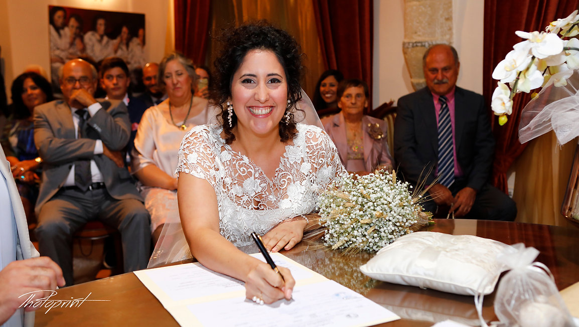 Bride signing marriage license on wedding contract  at  Larnaca municipality | cyprus wedding packages lebanon