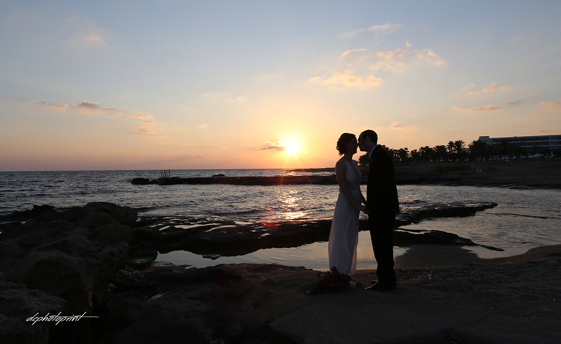 Bride and Groom, Kissing at Sunset on a Beautiful Mediterranean Paphos Beach | cyprus wedding Paphos wedding photography prices,cyprus wedding Paphos wedding photography