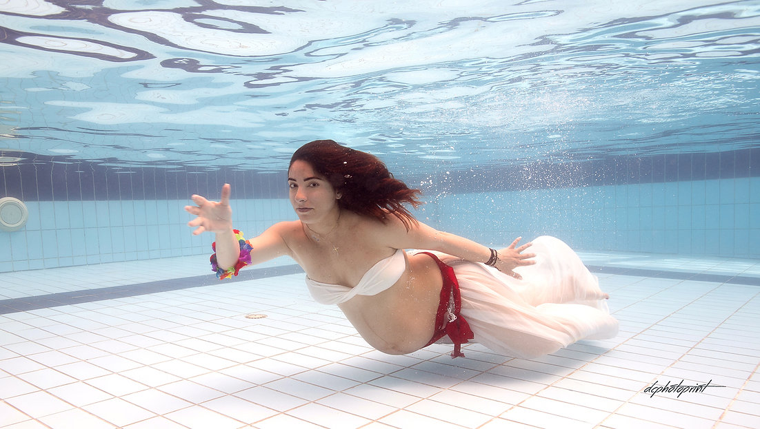 Picture of Elegant beautiful Just married romantic Bride underwater in a pool | ayia napa underwater wedding photography, wedding in ayia napa underwater photographer