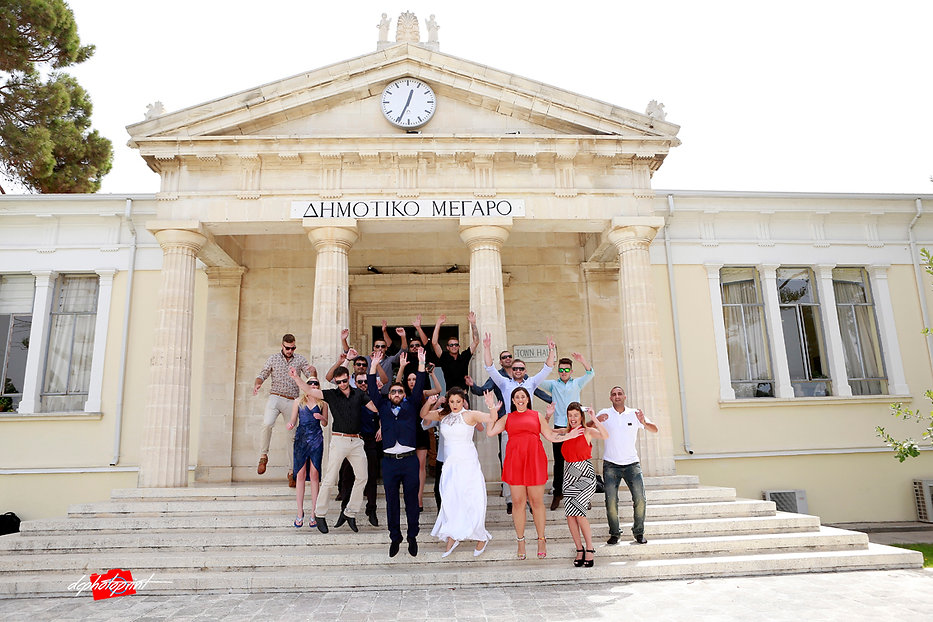 Photo outside the Paphos Town Hall with Alex and Karina Slo and all the guests from Israel , wedding photographer paphos prices, maried in paphos municipality cyprus