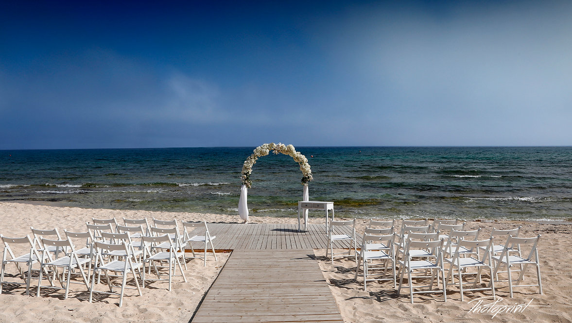 Wedding on the beach. Wedding arch decorated with flowers on Mediterranean sand beach |  olympic lagoon resort ayia napa photographer, Thalassines beach wedding photographer,  Thalassines beach wedding cyprus, Ayia Thekla Beach - Weddings in Cyprus, ayia napa weddings - beach weddins, ayia napa wedding photographers prices.