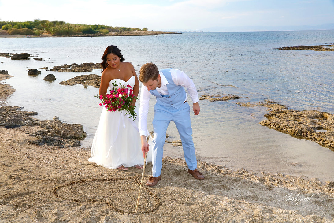 Heart symbol in the sand by Atilla for Sandra after the wedding | cyprus sunset images wedding photography