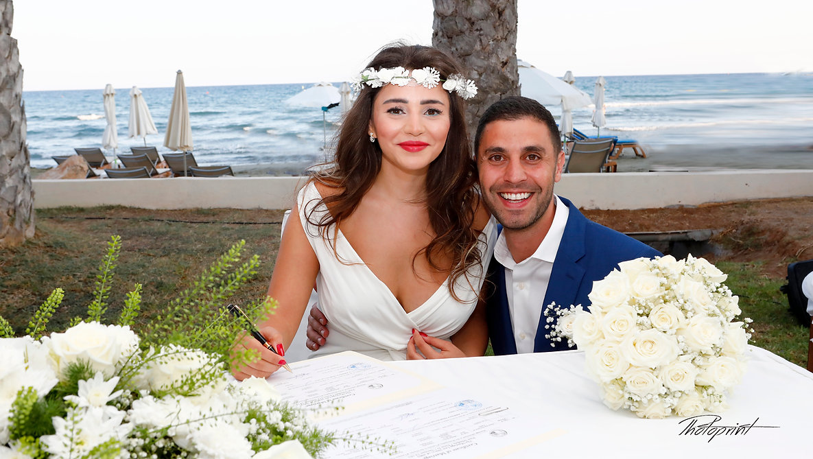 Happy young Bride signing wedding registration form in Golden Bay Beach Hotel, Larnaca | cyprus wedding larnaca photographers, Larnaca Wedding photographer | Professional Photography