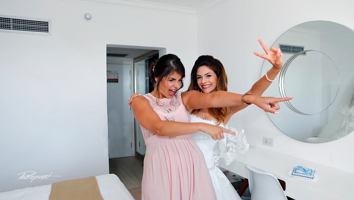 Bride and bridesmaid have a small party before the wedding ceremony | wedding photographers protaras |  wedding protaras photographers, wedding photography ideas protaras cyprus