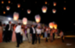 Hot air balloons jostle for space in the Sky over the wedding party in Larnaca at night | larnaca lebanese Wedding Photographers, cyprus wedding photography prices for small weddings
