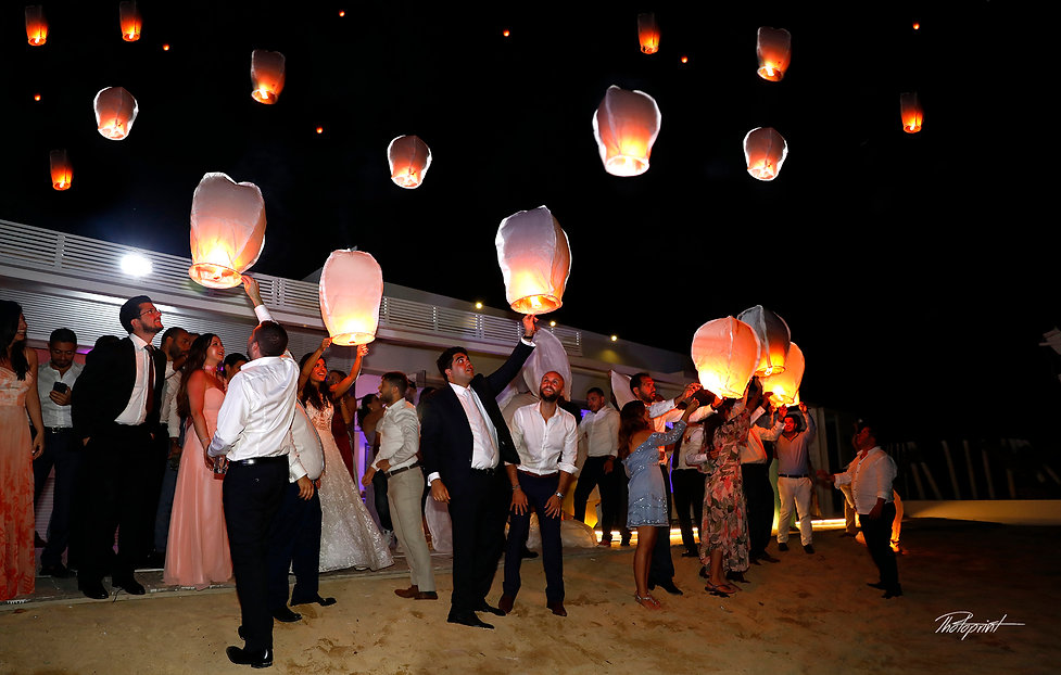 Hot air balloons jostle for space in the Sky over the wedding party in Larnaca at night